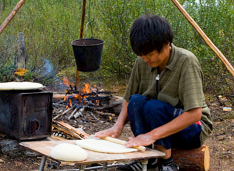 Evenki reindeer herder is making traditional Evenki bread – tupa. Neryungri District, Republic of Sakha (Yakutia), Russia. Credit: Yuri Kokovin